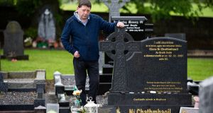 Micheál Cunningham at the Lismaconly Cemetery grave of  his murdered daughter Ciara Ní Chathmhaoil. Photograph:  Tom Honan