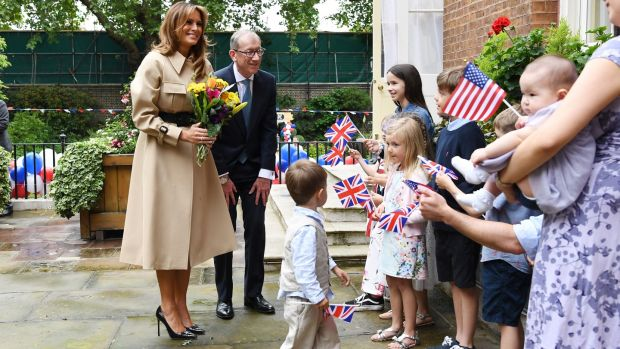 First lady fashion: Melania Trump's trench coat suited the wet weather at a Downing Street garden party. Photograph: Facundo Arrizabalaga EPA/Pool/Getty