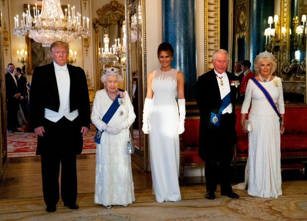 State banquet: her hair swept up, Melania Trump wore a Dior haute-couture white column dress with elbow-length white gloves for the state banquet hosted by Queen Elizabeth. Photograph: Doug Mills/New York Times