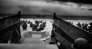 US troops rush to the Normandy beaches  during the D-Day landing. Photograph: Photo12/UIG via Getty Images