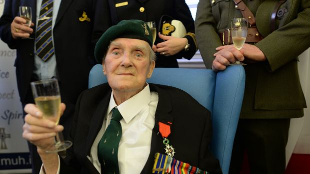 Sgtt Pat Gillen , who landed on Sword Beach on June 6th, 1944, receives the Legion of Honour at Mercy Hospital, Cork, from the French ambassador in December 2014. Photograph: Artur Widak/NurPhoto via Getty Images