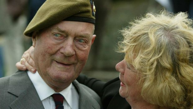 Former Irish Guardsman Jack Johnstone who took part in the Normandy landings 60 years ago is comforted by his niece Sylvia Tennant as he salutes fallen comrades at an emotional D-Day service held at Irish National War Memorial, in Dublin. Photograph: Gareth Fuller /PA Images via Getty Images