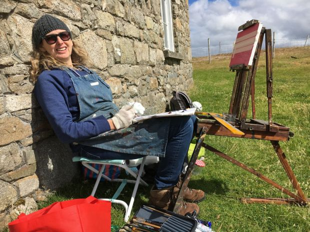 Una Sealy working at the schoolhouse on Barbara Warren's old field easel, on Inishlacken. Photograph: Nancy Keefe Rhodes