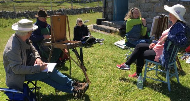"""The third week in June is when we now go to the island; the longest days and shortest nights make for optimum work time."" Michael Doherty, Mick O'Dea, Ann Marie Mullan and Una Sealy making  portrait of island descendant Claire King at Inishlacken schoolhouse, 2018. Photograph: Nancy Keefe Rhodes"