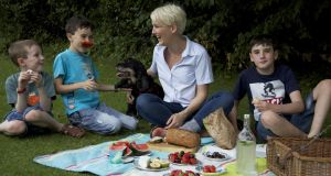 Isaac Reid (age 6), Peter Reid (age 9), Catherine Cleary, and Shane Reid (age 12) have a picnic in Iveagh Gardens. Photograph: Sara Freund/The Irish Times
