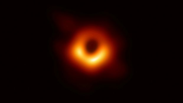 The first-ever photograph of a black hole, taken using a global network of telescopes, and released in April. Photograph: Event Horizon Telescope/National Science Foundation/Reuters