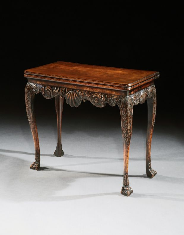 Side table with intricate frieze, which had been on loan to Malahide Castle.