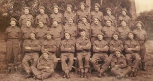Vintan Donohoe (sitting on grass, left) with his platoon.