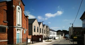 The Dún Laoghaire estate of 12 houses is close to the sea front and the town centre. It is the first 'rapid' or 'modular' housing scheme by local authorities to tackle the homelessness and housing crises to be shortlisted for the awards.