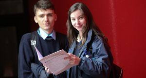 Applied Leaving Certificate students, Louis Murphy and Skyi Tobin  with the English and Communication paper after they sat the exam at St Tiernan's Community College in Dundrum, Dublin. Photograph: Laura Hutton/The Irish Times