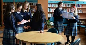 From left:  Katelyn Hart, Miruna Toma, Anna Piela, Andreea Sandy, with Casey Ralph and Geri Dornan, look over the Leaving Cert English paper at Mount Carmel Secondary School,  Dublin. Photograph: Dara Mac Dónaill / The Irish Times
