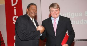 "Denis O'Brien with Baldwin Spencer, ex-prime minister  of Antigua and Barbuda. Digicel claims the confiscation of its high-speed spectrum would mean ""significant mobile disruption""  for 18 months"