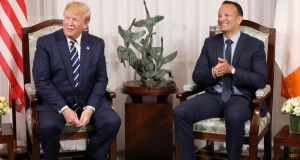 US president Donald Trump  and Taoiseach Leo Varadkar at Shannon airport on Wednesday. Mr Varadkar said they also  discussed the taxation in Ireland of large companies. Photograph:  Pool/Getty Images
