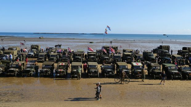 Military vehicles line the beach at Arromanches in Normandy, northern France, ahead of D-Day commemorations on Thursday. Photograph: Gareth Fuller/PA Wire