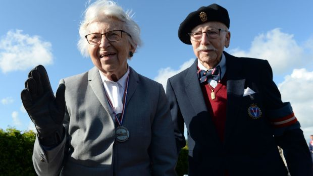 Danish second World War veteran Antoinette Melgaard (97) and Danish member of the resistance Poul Hoeg following a ceremony on Utah Beach in Sainte-Marie-du-Mont, Normandy on Thursday. Photograph: Jean-Francois Monier/AFP/Getty Images
