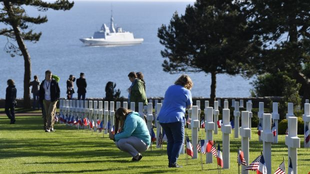 Attendees inspect headstones at the Normandy American Cemetery and Memorial in Colleville-sur-Mer, France, on Thursday. Photograph: Geert Vanden Wijngaert/Bloomberg