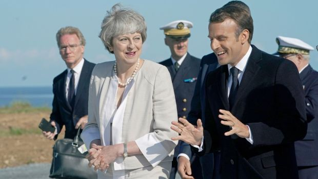 British prime minister Theresa May and French president Emmanuel Macron at Ver-sur-Mer, France, during D-Day commemorations on Thursday. Photograph: Owen Humphreys/PA Wire
