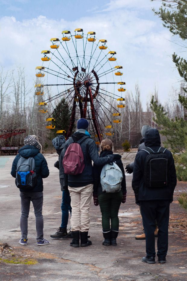 Group of tourists in front of the Ferris wheel in Pripyat, near Chernobyl's nuclear power plant. Photograph: iStock/Getty Images