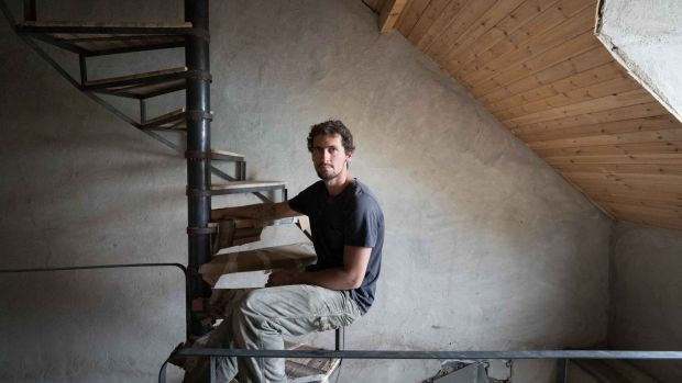 Harrison Gardner at work on an old house in Ennistymon, Co Clare. Photograph: Eamon Ward