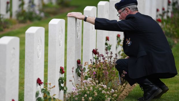 A veteran views graves ahead of a remembrance ceremony at the Commonwealth War Graves Cemetery at Bayeux, France. Photograph: Neil Hall/EPA