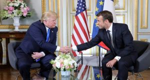 US president Donald Trump  and French president Emmanuel Macron shake hands during a meeting at Caen, Normandy, northwestern France. Photograph: Ludovic Marin/AFP/Getty Images