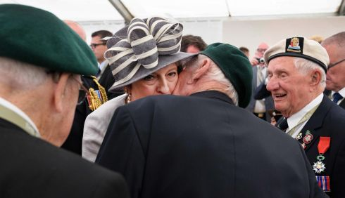 MAY: British prime minister Theresa May (centre) is kissed by veteran Robert Yaxley following a service of remembrance at Bayeux cemetery Bayeux, France as part of D-Day commemorations. Photograph: Leon Neal/pool/AFP/Getty