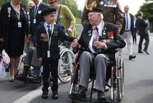 YOUNG AND OLD:  D-Day veteran John Quinn meets George Sayer (6) in Bayeaux, France on the 75th anniversary of the D-Day landings. Photograph: Jane Barlow/PA Wire