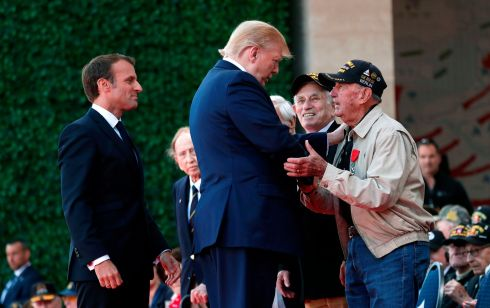 GREETING: US president Donald Trump (centre) and French president Emmanuel Macron (left) greet a US veteran during a French-US ceremony at the Normandy American Cemetery and Memorial in Colleville-sur-Mer, Normandy, northwestern France. Photograph: Ian Langsdon/pool/AFP/Getty