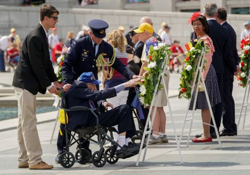 REMEBERING: A second World War veteran reaches out during a wreath laying during the commemoration of the 75th anniversary of the D-Day landings at the World War II Memorial in Washington, US on Thursday. Photograph: Kevin Lamarque/Reuters