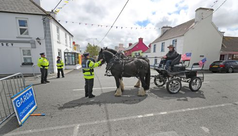 HORSE OUTSIDE: Tour operator Mick O'Dea is stopped at a Garda checkpoint as he makes his way through the the village of Doonbeg in Co Clare during the visit of US president Donald Trump. Phototgraph: Niall Carson/PA Wire
