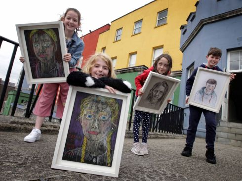 EXHIBITION: From left, Jasmin Maher (11), Eabha Cunnane (8) both portraits by Kathy Tynon, Charlie Rose Aston (8) portriat by Vera Klute and Liam Howard Ihle (11) portriat by Alison Pilkighton as part of The Ark's special portrait exhibition of over 100 drawings of children by some of Ireland's best known artists, which is hung in The Coach House, Dublin Castle. The exhibition is part of a brand-new festival created for children - by children, Right Here Right Now! The Ark's Festival of Children running from June 13th to 16th, a special weekend  of art, theatre, dance, games and film awaits and all events will be free. Photograph: Mark Stedman