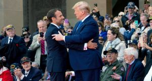 French president Emmanuel Macron and US president Donald Trump embrace at the Normandy American Cemetery in Colleville-sur-Mer on Thursday. Photograph: Doug Mills/New York Times