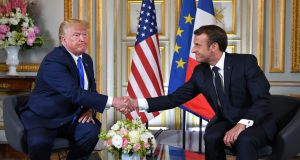 US president Donald Trump and French president Emmanuel Macron   shake hands during the press conference in  Normandy, June 6th. Photograph: Mandel Ngan/AFP/Getty
