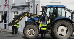 A tractor stops at a Garda checkpoint in Doonbeg in Co Clare during the visit of US president Donald Trump. Photograph: Niall Carson/PA Wire