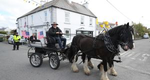 Tour operator Mick O'Dea makes his way through Doonbeg in Co Clare during the visit of US president Donald Trump. Photograph: Niall Carson/PA Wire