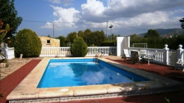 This finca sits in fenced land with a swimming pool and a football pitch.