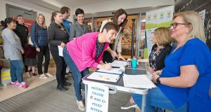 Parents  sign a petition to review Ratoath College's iPad-only policy, organised by a group of concerned parents, at the village supermarket. Photograph: Dave Meehan