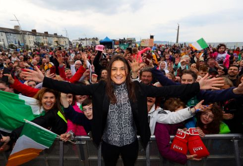 HERO'S WELCOME: Katie Taylor stands before the crowd attending her welcome home parade in her native Bray, Co Wicklow on Friday evening. Photograph: Tommy Dickson/Inpho