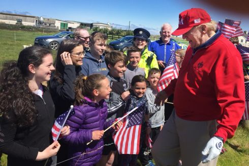 COMMANDER IN CHIEF: US president Donald Trump greets schoolchildren and teachers from Clohanes National School at his golf resort in Doonbeg, Co Clare during his recent Irish visit. Mr Trump and first lady Melania left Ireland after a two night stay on Friday. Photograph: PA Wire