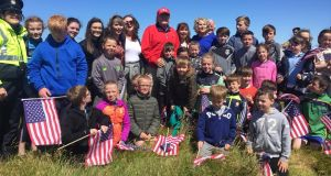 "US president Donald Trump with schoolchildren in Doonbeg: ""Come on, come on, let them up,"" he said to the Secret Service agents. Photograph: Abbi Shanahan/Brian Shanahan/Reuters"