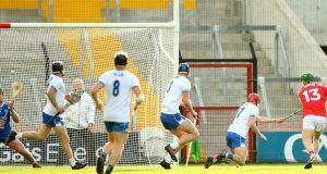Alan Cadogan scores Cork's second goal against Waterford. Photograph: James Crombie/Inpho