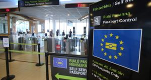 New electronic passport readers will be in place at both terminals in Dublin Airport from Tuesday  in an attempt to significantly reduce delays at immigration control. File photograph: Niall Carson/PA Wire.