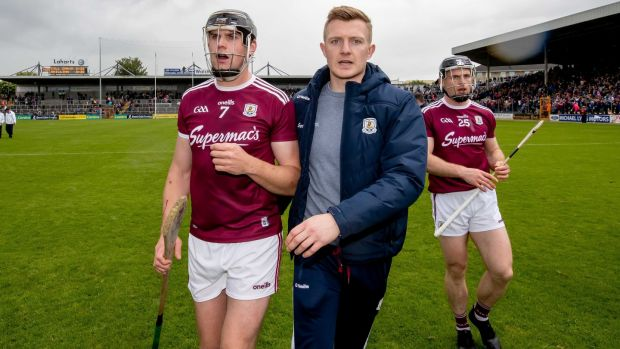 Joe Canning congratulates Joe Cooney after the game. Photograph: Morgan Treacy/Inpho