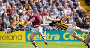 Kilkenny's Huw Lawlor tries to block Conor Whelan of Galway. Photograph: Morgan Treacy/Inpho