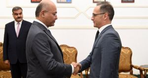 Iraqi president Barham Salih  meeting Germany's minister of foreign affairs Heiko Maas in Baghdad on Saturday.  Handout photograph: EPA