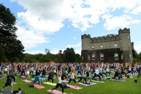 HOT YOGA: Yoga in the Park, organised by Hot Yoga Dublin in aid of Chernobyl Children International, LauraLynn and St Michael's House, at Malahide Castle and Gardens, Malahide, Co Dublin. Photograph: Dara Mac Donaill