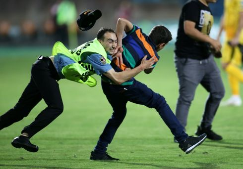 HATS OFF: A steward tackles a pitch invader during a Euro 2020  Group J qualifying game between Armenia and Liechtenstein, at Vazgen Sargsyan Republican Stadium, Yerevan, Armenia. Armenia won 3-0. Photograph: Irakli Gedenidze/Reuters