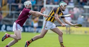 Cathal Mannion with Kilkenny's Paddy Deegan at Nowlan Park. The Galway man gave a master class in forward play during the Leinster championship clash. Photograph: Morgan Treacy/Inpho
