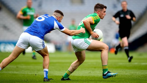 Meath's Donal Keogan and Robert Pigott of Laois during their Leinster Championship semi-final match at Croke Park, Dublin, on Sunday. Photograph: Ryan Byrne/Inpho