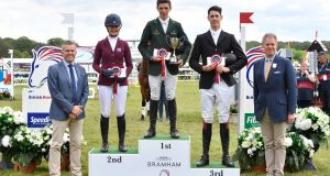 Cathal Daniels stands on the top of the podium following victory in the CCI-L U25 4* at the Bramham International Horse Trials. Photograph: Kit Houghton/Horse Sport Ireland